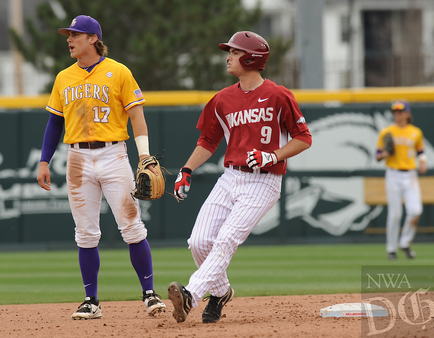 NWA Democrat-Gazette/ANDY SHUPE - Clark Eagan (9) of Arkansas rounds second after nearly hitting a home run as second baseman Jared Foster of LSU watches during the fifth inning Saturday, March 21, 2015, at Baum Stadium in Fayetteville. Visit nwadg.com/photos for more photos from the game.