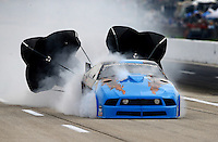 Apr 24, 2015; Baytown, TX, USA; NHRA pro mod driver Kevin Fiscus blows an engine during qualifying for the Spring Nationals at Royal Purple Raceway. Mandatory Credit: Mark J. Rebilas-