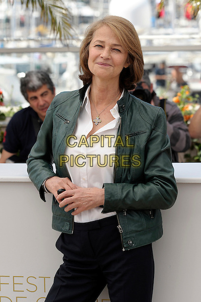 CHARLOTTE RAMPLING  .'The Look' photocall, 64th International Cannes Film Festival, France.16th May 2011.half length white shirt green leather jacket.CAP/JG.©Jacques Garrel/Capital Pictures