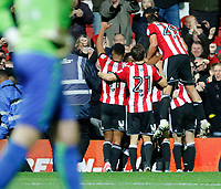 GOAL - Ryan Woods of Brentford celebrates with team mates during the Sky Bet Championship match between Brentford and Leeds United at Griffin Park, London, England on 4 November 2017. Photo by Carlton Myrie.