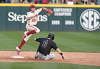 Arkansas' Casey Martin watches his throw to first base after catching Grand Canyon University's Brock Burton at second Wednesday March 11, 2020 at Baum-Walker Stadium in Fayetteville. Visit nwaonline.com/200312Daily/ for more images. (NWA Democrat-Gazette/J.T. Wampler)