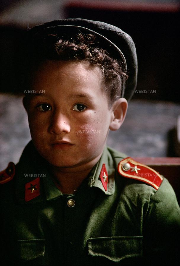 1995. Portrait d'un &eacute;colier tadjik portant une casquette et un uniforme chinois &agrave; Gourtouchlough. / Portrait of a Tajik schoolboy wearing a cap and a Chinese uniform in Gurtuchlugh.<br /> HEMIS diffusion