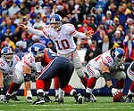 23 December 2007: New York Giants quarterback Eli Manning call out a play against the Buffalo Bills at Ralph Wilson Stadium in Orchard Park, NY. The Giants defeated the Bills 38-21. ..Mandatory Photo Credit: Ed Wolfstein Photo