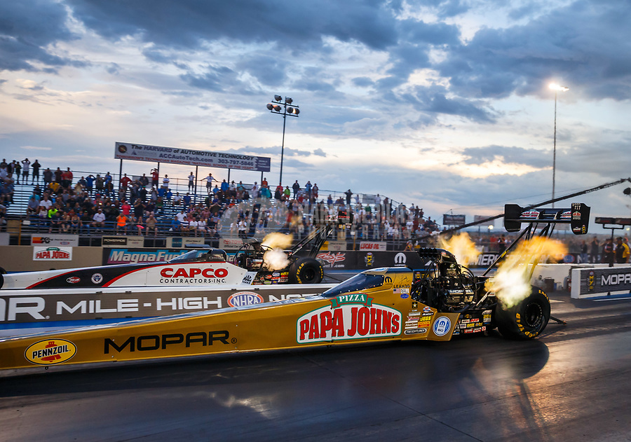 Jul 21, 2017; Morrison, CO, USA; NHRA top fuel driver Leah Pritchett (near) races alongside Steve Torrence during qualifying for the Mile High Nationals at Bandimere Speedway. Mandatory Credit: Mark J. Rebilas-USA TODAY Sports