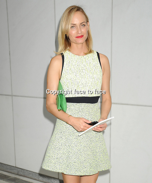 NEW YORK, NY - SEPTEMBER 11: Amber Valletta seen outside of the Proenza Schouler Spring 2014 Fashion Show in Midtown Manhattan during New York Fashion Week in New York, NY. September 11, 2013. <br />