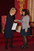 London, Uk. 15/10/2015. HRH The Duchess of Cornwall with Martina Watler, 13, Junior Runner-up, from St Ignatius Catholic School in the Cayman Islands. The Duchess of Cornwall on behalf of Her Majesty The Queen, Patron of The Royal Commonwealth Society, holds a reception for winners of The Queen's Commonwealth Essay Competition at Buckingham Palace. The Queen's Commonwealth Essay Competition was founded in 1883 and is the world's oldest international schools' writing contest. This year's competition, sponsored by Cambridge University Press, received more than 13,000 entries from over 600 schools in 49 Commonwealth countries and territories. The Duchess of Cornwall hands out awards to young writers who have travelled from across the Commonwealth to attend the reception. This year's winners have come from Cyprus, Botswana, The Cayman Islands and as far away as Tristan da Cunha - over 9000km away.