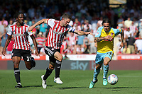 Ryan Williams of Rotherham races upfield as Brentford's Henrik Dalsgaard looks on during Brentford vs Rotherham United, Sky Bet EFL Championship Football at Griffin Park on 4th August 2018