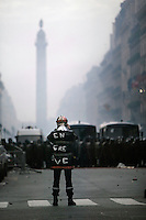 25 March 2004 - Paris, FRA - A firefighter photographs a riot police cordon near the Place Vendome in Paris after marching with colleagues through the city, 25 March 2004, to demand that their profession be classified as a dangerous occupation which entails various social security benefits including early retirement. The confrontation with riot police left 2 firefighters and 20 policemen injured.