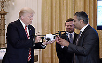 United States President Donald J. Trump holds a drone as George Mathew CEO &amp; Chairman of Kespry explaines how it work during  the American Leadership in Emerging Technology Event in the East Room of the White House in Washington, DC, on June 22, 2017. <br /> Credit: Olivier Douliery / Pool via CNP /MediaPunch