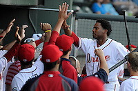 Right fielder Aneury Tavarez (5) of the Greenville Drive is congratulated after scoring in a game against the Savannah Sand Gnats on Wednesday, May 29, 2013, at Fluor Field at the West End in Greenville, South Carolina. Greenville won, 5-1. (Tom Priddy/Four Seam Images)