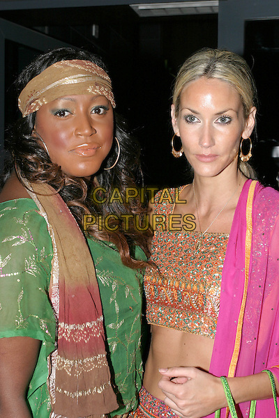 "MICA PARIS & LISA BUTCHER.Premiere of ""The Day After Tomorrow"", London,.26th May 2004..half length half-length head scarf fushia pink indian style top hoop earings.www.capitalpictures.com.sales@capitalpictures.com.©Capital Pictures"