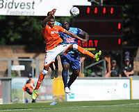 Blackpool's Michael Nottingham vies for possession with Wycombe Wanderers' Adebayo Akinfenwa<br /> <br /> Photographer Kevin Barnes/CameraSport<br /> <br /> The EFL Sky Bet League One - Wycombe Wanderers v Blackpool - Saturday 4th August 2018 - Adams Park - Wycombe<br /> <br /> World Copyright &copy; 2018 CameraSport. All rights reserved. 43 Linden Ave. Countesthorpe. Leicester. England. LE8 5PG - Tel: +44 (0) 116 277 4147 - admin@camerasport.com - www.camerasport.com