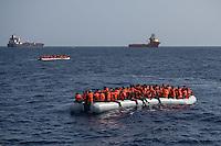 """Sea Watch-2.<br /> Die Sea Watch-2 bei ihrer 13. SAR-Mission vor der libyschen Kueste.<br /> Im Bild: Ein ueberfuelltes Schlauchboot mit ca. 150 Gefluechteten. Sie trieben ueber Stunden orientierungslos herum, denn der Motor wurde ihnen von sog. """"Engine-Fischern"""" abgenommen. Die Crew der Sea Watch-2 versorgte sie ueber mehrere Stunden mit Wasser, bis sie von der italienischen Kuestenwache geborgen werden konnten.<br /> 22.10.2016, Mediterranean Sea<br /> Copyright: Christian-Ditsch.de<br /> [Inhaltsveraendernde Manipulation des Fotos nur nach ausdruecklicher Genehmigung des Fotografen. Vereinbarungen ueber Abtretung von Persoenlichkeitsrechten/Model Release der abgebildeten Person/Personen liegen nicht vor. NO MODEL RELEASE! Nur fuer Redaktionelle Zwecke. Don't publish without copyright Christian-Ditsch.de, Veroeffentlichung nur mit Fotografennennung, sowie gegen Honorar, MwSt. und Beleg. Konto: I N G - D i B a, IBAN DE58500105175400192269, BIC INGDDEFFXXX, Kontakt: post@christian-ditsch.de<br /> Bei der Bearbeitung der Dateiinformationen darf die Urheberkennzeichnung in den EXIF- und  IPTC-Daten nicht entfernt werden, diese sind in digitalen Medien nach §95c UrhG rechtlich geschuetzt. Der Urhebervermerk wird gemaess §13 UrhG verlangt.]"""