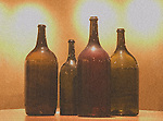 Bottles displayed in Virginia winery show variety of sizes, mostly historical.