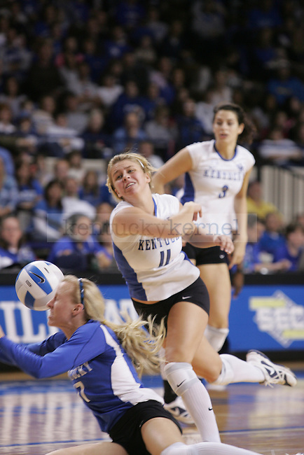UK's Stephanie Klefot, middle, and BriAnne Sauer attempt to keep the ball in play against the University of Florida at Memorial Coliseum Sunday afternoon. Photo by Scott Hannigan | Staff