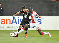 Chris Pontius (13) of D.C. United goes against Pa Modou Kah (44) of the Portland Timbers. The Portland Timbers defeated D.C. United 2-0, at RFK Stadium, Saturday May 25 , 2013.