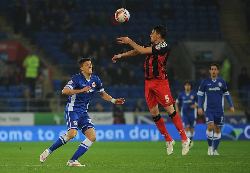 Cardiff City's Alex Revell vies for possession with Bournemouth's Tommy Elphick<br /> <br /> Photographer Kevin Barnes/CameraSport<br /> <br /> Football - The Football League Sky Bet Championship - Cardiff v Bournemouth - Tuesday 17th March 2015 - Cardiff City Stadium - Cardiff<br /> <br /> &copy; CameraSport - 43 Linden Ave. Countesthorpe. Leicester. England. LE8 5PG - Tel: +44 (0) 116 277 4147 - admin@camerasport.com - www.camerasport.com