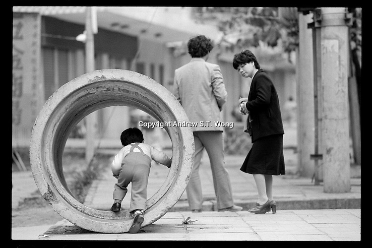 A Chinese couple and their son enjoy a quiet afternoon in China's Shenzhen Special Economic Zone on the border with Hong Kong, 1987.