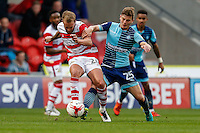 James Coppinger of Doncaster Rovers and Dominic Gape of Wycombe Wanderers  battle for the ball during the Sky Bet League 2 match between Doncaster Rovers and Wycombe Wanderers at the Keepmoat Stadium, Doncaster, England on 29 October 2016. Photo by David Horn.