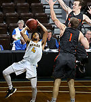 SIOUX FALLS, SD - MARCH 9:  Wes Stowers #4 from Marian shoots against Max Huber #2 and Joel Wincowski #1 from Indiana Tech during their second round game at the 2018 NAIA DII Men's Basketball Championship at the Sanford Pentagon in Sioux Falls. (Photo by Dave Eggen/Inertia)