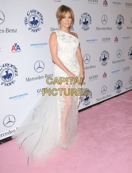JENNIFER LOPEZ .at The 32nd Annual Carousel of Hope Ball held at The Beverly Hilton hotel in Beverly Hills, California, USA, .October 23rd 2010..full length one shoulder white sheer dress  see thru through tulle long maxi gown train clutch bag                                                                      .CAP/RKE/DVS.©DVS/RockinExposures/Capital Pictures.