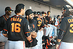 SF Giants' from left Angel Pagan, Sergio Romo and Brandon Crawford talk before a spring training game in Peoria, Ariz., on Wednesday, March 16, 2016. <br />