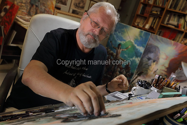 Portrait of Grzegorz Rosinski, Polish comic book artist, born 1941 in Stalowa Wola, Poland, at work on a pastel picture of Thorgal in his new studio, Mollens, Sierre, Switzerland, 9th September 2016. Rosinski is the author and designer of many Polish comic book series, and created Thorgal with Belgian writer Jean Van Hamme in 1977. The stories cover Norse mythology, Atlantean fantasy, science fiction, horror and adventure genres. Picture by Manuel Cohen