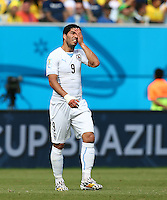 Luis Suarez of Uruguay shows a look of dejection