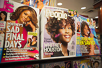 Tabloid magazines US, People and In Touch feature the death of the singer Whitney Houston on their covers, seen on Saturday, February 18, 2012, the day of her funeral. (© Richard B. Levine)