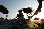 A Bangladeshi woman breaks stone to earning livelihood in Rangpur, outskirts of Dhaka, Bangladesh. The workers earn less than US$3 a day.
