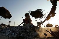 A Bangladeshi woman breaks stone to earning livelihood in Rangpur, outskirts of Dhaka, Bangladesh. The workers earn less than US$3 a day.