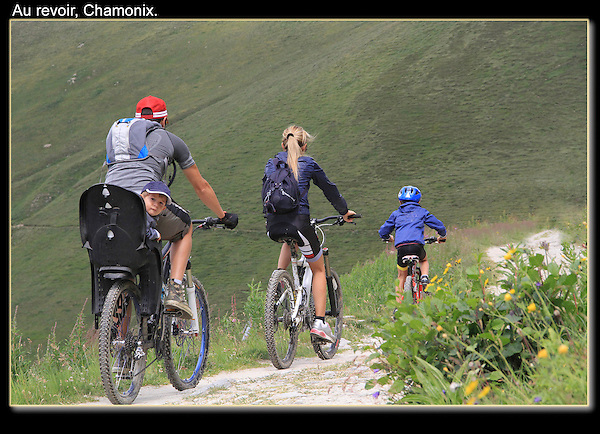 Family cycling at Le Tour, Chamonix, France.