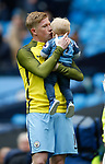 Kevin De Bruyne of Manchester City kisses his son Mason before the English Premier League match at the Etihad Stadium, Manchester. Picture date: May 13th 2017. Pic credit should read: Simon Bellis/Sportimage