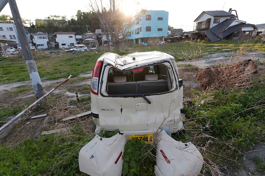 Damaged cars and tsunami damages houses in the town of Tomioka, Futaba District of Fukushima, Japan. Monday April 29th 2013. The town was evacuated on March 12th after the March 11th 2011 earthquake and tsunami cause meltdowns at the nearby Fukushima Daichi nuclear power station. It lies well within the 20 kms exclusion zone though parts of the town were opened in spring 2013 again to allow locals to visit their property during daylight hours.