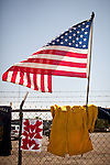 A wildland firefighter's Nomex shirt is hung at a makeshift memorial outside Fire Station 7 in Prescott, Arizona, July 2, 2013, the home of the 19 Granite Mountain Hotshots who perished in the Yarnell Fire Sunday.