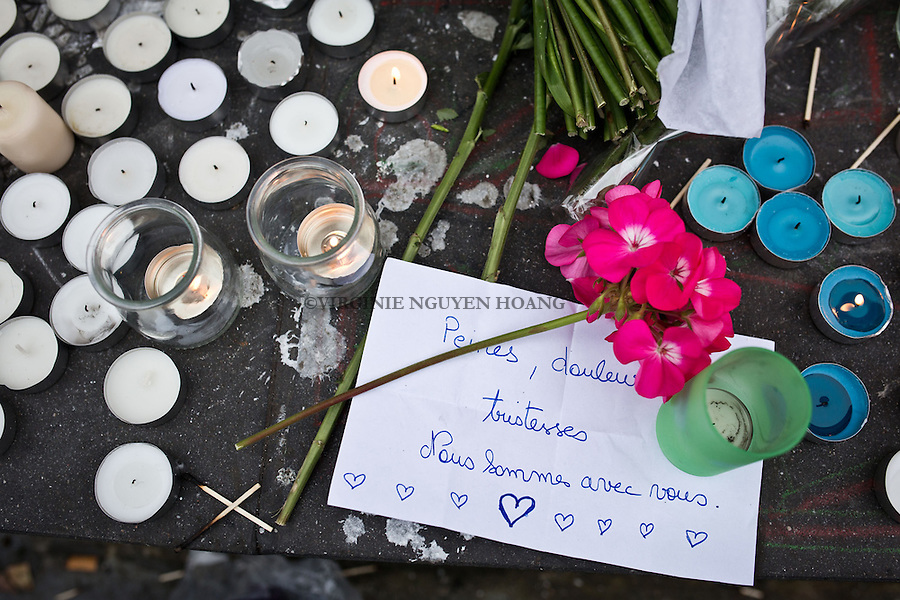 PARIS, FRANCE - NOVEMBER 14: Fowers left at Place de la Republique in memories of the people killed during the terrorost attacks of the November 13. On the paper is writen: Pain,gried, sadeness, we are with you. The attacks of the 13th of November killed 129 people in Paris and injured 352 .
