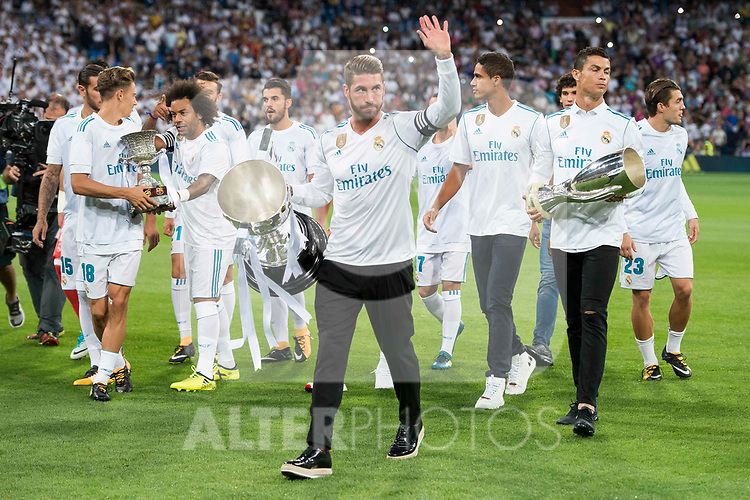 Real Madrid's Theo Hernandez, Marcos Llorente, Marcelo, Sergio Ramos, Raphael Varane, Cristiano Ronaldo and Mateo Kovacic receive La Liga 2016-2017 Cup before La Liga match between Real Madrid and Valencia CF at Santiago Bernabeu Stadium in Madrid, Spain August 27, 2017. (ALTERPHOTOS/Borja B.Hojas)