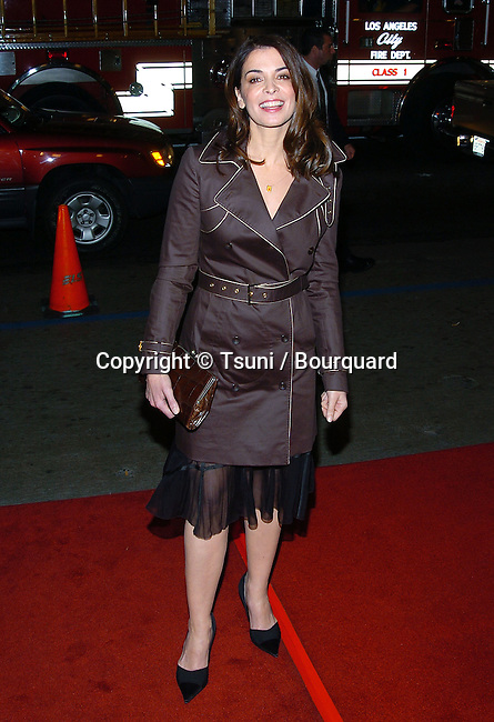 "Annabella Sciorra arriving at the "" Chasing Liberty "" Premiere at the Chinese Theatre in Los Angeles. January 7, 2004."