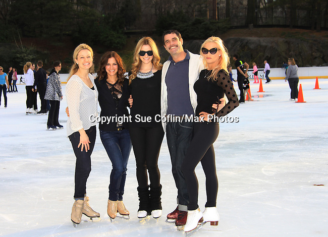 All My Children Rebecca Budig poses with figure skaters Canadian Pair Skater Sandra Bezie, Tanith Belbin  (American Figure Skater), Douglas Webster (artistic director Ice Theatre of New York) and Nicole Bobec (American Figure Skater) - The 2013 Skating with the Stars- a benefit gala for Figure Skating in Harlem on April 8, 2013 at Trump Wollman Rink, New York City, New York. (Photo by Sue Coflin/Max Photos)