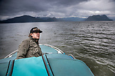CANADA, Vancouver, British Columbia, Eric Petersen drives his boat out to Port Graves, Gambier Island in the Howe Sound
