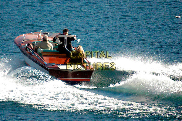 "LAURA LINNEY & ANTONIO BANDERAS.""The Other Man"" filming in Cernobbio, Como's Lake, Cernibbio, Italy..March 7th, 2008.movie set shooting boat water crew full length sitting scarf .CAP/ADM/Liverani/EG.©Elena Gaffuri/Liverani/AdMedia/Capital Pictures"