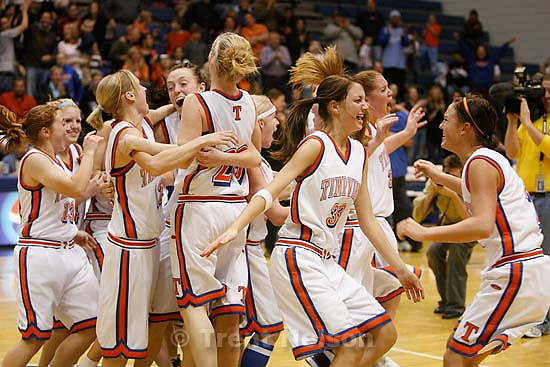 Timpview players swarm onto the court to celebrate their championship. Taylorsville - Timpview wins the state championship. Orem vs. Timpview High School, 4A Girls State Basketball Championship game at Salt Lake Community College.