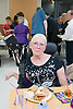 Woman with cerebral Palsy at a friend's birthday party,