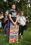 """It's incumbent for people to take their thoughts and turn them into actions,"" said Matthew Mirachi, of Seattle, standing alongside Katie Rogers as protestors gather at Denny Park during the Solidarity Against Hate rally Sunday August 13, 2017 in Seattle, a response to the violent and deadly protests in Charlottesville, Virginia the day prior."