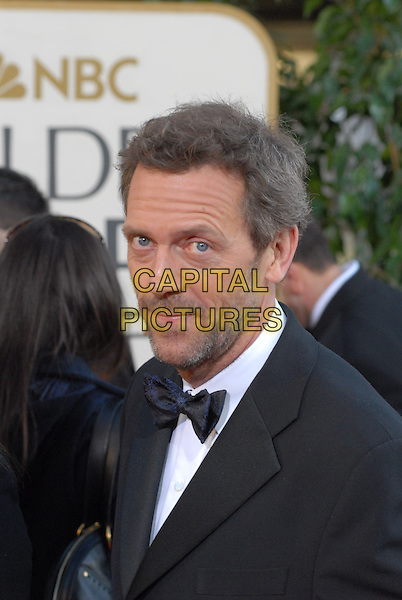 """HUGH LAURIE.Red Carpet Arrivals - 64th Annual Golden Globe Awards, Beverly Hills HIlton, Beverly Hills, California, USA..January 15th 2007.globes headshot portrait bow tie stubble facial hair .CAP/AW.Please use accompanying story.Supplied by Capital Pictures.© HFPA"""" and """"64th Golden Globe Awards"""""""