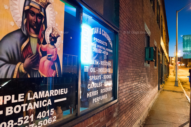 """Temple Lamardieu Botanica sells Haitian and Caribbean products in downtown Brockton, Massachusetts, USA, on Wed., March 29, 2017. Despite the sign saying """"Open"""" the business was closed."""