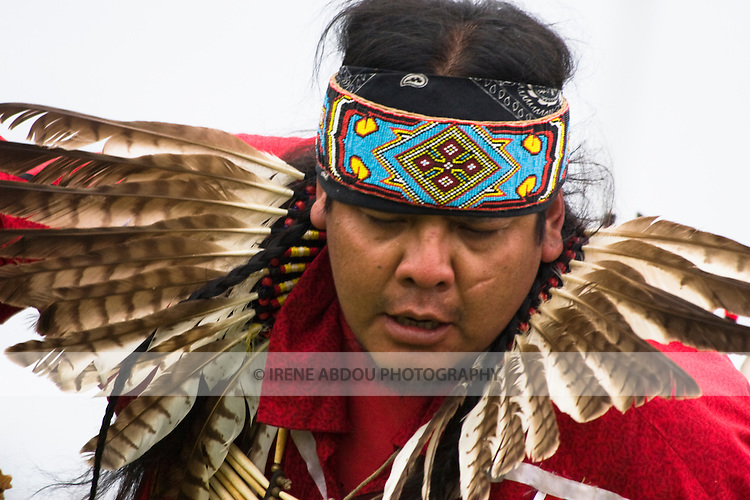 A Native American man in full traditional regalia dances at the Healing Horse Spirit Pow-Wow in Mt. Airy, Maryland.