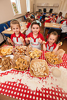 Rainbows learn to make bread at ASDA Newark - pictured from left areEllie-Rose Moore, 6, Megan Horbury, 6 and Amber Keeley, 5