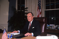 Washington DC., USA, October 2, 1990<br /> President George H.W. Bush in the Oval Office of the White House as he prepares to sign the Budget agreement. Credit: Mark Reinstein/MediaPunch