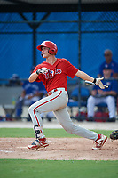 GCL Phillies West right fielder Trent Bowles (21) follows through on a swing during a game against the GCL Blue Jays on August 7, 2018 at Bobby Mattick Complex in Dunedin, Florida.  GCL Blue Jays defeated GCL Phillies West 11-5.  (Mike Janes/Four Seam Images)